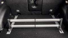 Telescopic bar for luggage compartment organizer